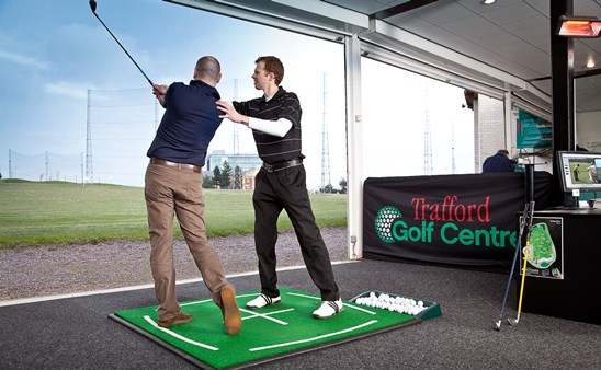 Pete Styles coaching a golfer at Trafford Golf Centre